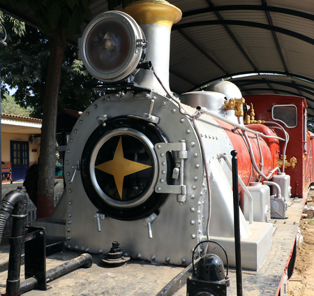 about age: Antique rail engine in National Rail Museum, New Delhi. One can see here about 150 years old engines, coaches, saloon and best preserved steam locomotive engines of its age. Editorial
