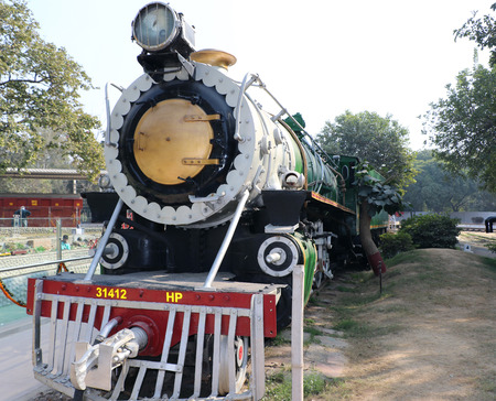 Antique rail engine in National Rail Museum, New Delhi. One can see here about 150 years old engines, coaches, saloon and best preserved steam locomotive engines of its age. Editorial