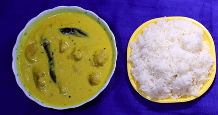 comfort food: Kadhi Pakoad and cooked rice; a comfort food of most Indian households. Indian cuisine, Indian style food.