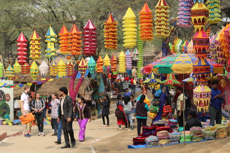indian fair: Visitors and local people are enjoying and shopping in Surajkund public craft fair in Surajkund, Faridabad, India. Editorial