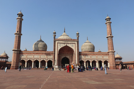 jama masjid: Jama Masjid of Delhi, is one of the largest mosques in India. Unidentified people walk in courtyard of Jama Masjid located in Old Delhi, India. The courtyard of the mosque can hold up to twenty-five thousand worshippers.