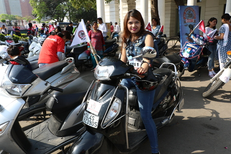 powerfull: New Delhi, India - March 13, 2016: On Sunday, March 13th i.e. 5 days after the International Womens Day, Navbharat Times (NBT) organized Delhis forth open All Women Bike Rally, flagged off by Delhis Chief Minister Arvind Kejariwal in Rajiv Chowk.