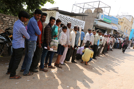 worthless: Crowds have been gathering outside banks across India, as people try to exchange or deposit money that became virtually worthless overnight. Editorial