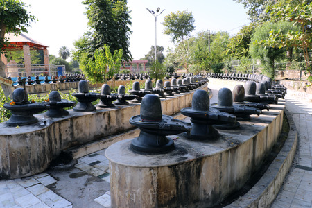 shivling: Shivpuri Dham Kota, Rajasthan is the only place where we able to see 525 Shivlingas. One shivling is 15 feet high & made of single black stone. Devotees come here to fulfill their wishes. Stock Photo