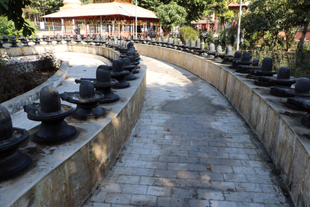 Shivpuri Dham Kota, Rajasthan is the only place where we able to see 525 Shivlingas. One shivling is 15 feet high & made of single black stone. Devotees come here to fulfill their wishes. Stock Photo
