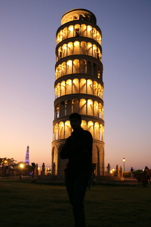 quite: The replica of Leaning Tower of Pisa in the Seven Wonders park, Kota the monument look quite beautiful in the evenings with good lightings and lake in the background. Editorial