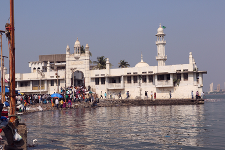 prestigious: Unidentified pilgrims at Haji Ali Dargah, a historical landmark and one of the most prestigious Islamic symbols situated in South Mumbai.