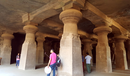 the archaic: Tourist hot-spot Elephanta caves, one of the oldest rock cut structures of India, perfect expressions of archaic Indian art associated to the cult of Lord Shiva. Editorial