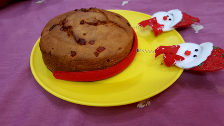 chrstmas: Christmas cake in yellow plate.
