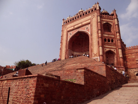 magnificence: Buland Darwaza, Fatehpur Sikri was built in 1576 A.D. by Akbar to commemorate his victory over Gujarat. Buland Darwaza, meaning high or great gate in Urdu. Stock Photo