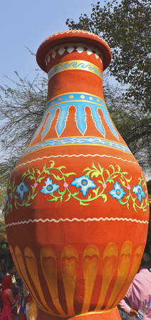 Decorative large earthen jar placed to attract visitors.