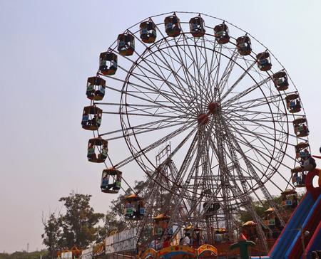 Visitors are enjoying at big swingsgiant wheel in Surajkund craft fair. Editorial