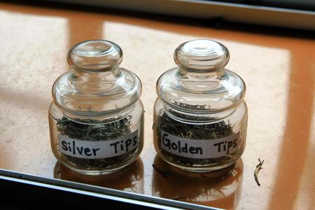 aftertaste: Glass jars with tea. Golden tea. Silver tea. Sri Lanka Stock Photo