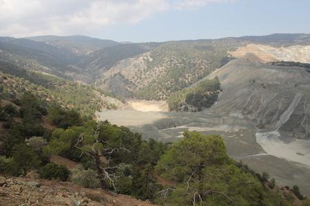 Mountain landscape. High gray mountains and sparse vegetation Фото со стока