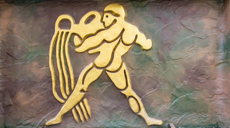 Aquarius sign of horoscope on the wall