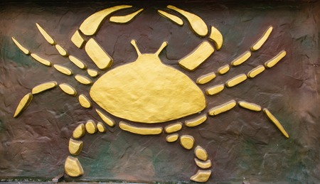 Cancer sign of horoscope on the wall