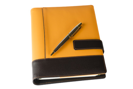 Orange notebook diary and pen isolated on white