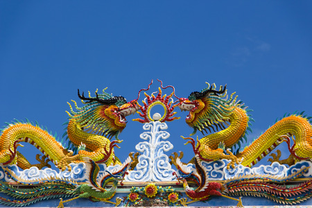 naga china: The twin Chinese dragon on temple roof in Thailand
