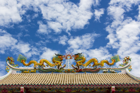 The twin Chinese dragon on temple roof in Thailand
