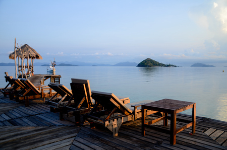 Wooden Beach Chairs on the floor near the beautiful sea in Trat, Thailand