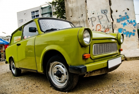 east berlin: East-German plastic vintage car parked near Berlin wall