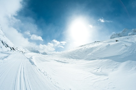 winter landscape with skiing tracks photo