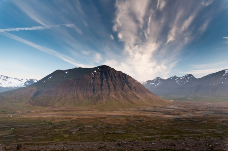 huge mountains in Iceland in wonderful light in evening photo