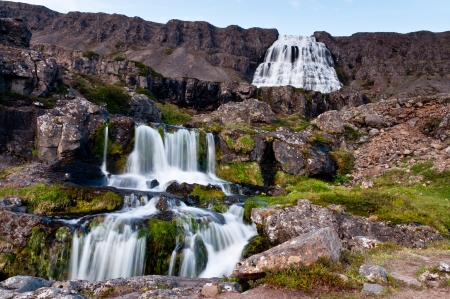 large waterfall with cascades, long exposure time photo