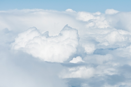 heavy clouds from above - airplane or spacecraft photo