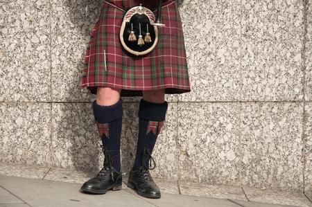 bagpiper dressed in kilt playing bag pipes Stock Photo