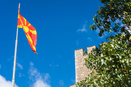 Stone castle and Macedonian flag Stock Photo