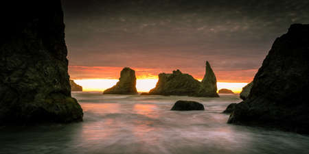 Fiery sunset over sea stacks in Bandon, Oregon, USA. Stock fotó