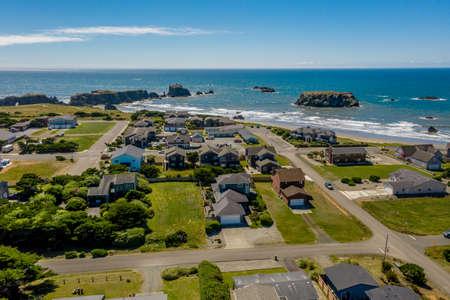 Aerial drone shot of coastal homes on bluff in Bandon, Oregon.