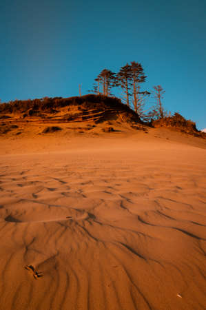 Red colored cliffs and sand of Cape Kiwanda in Pacific City, Oregon