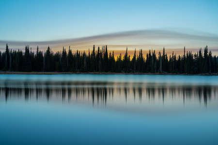 Sunrise at Cascade lake in Oregon during 2020 fire season with orange sky