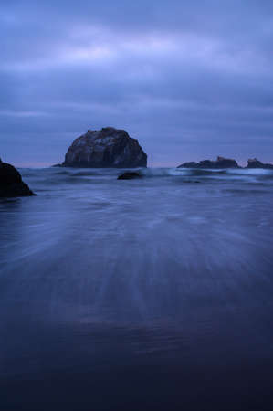Water streaks in front of Face Rock in Bandon, Oregon