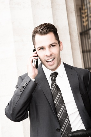 reachable: Young businessman using a mobile phone