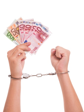 counterfeit: Hands, handcuffs and Euro notes - conceptual shot around counterfeit money Stock Photo