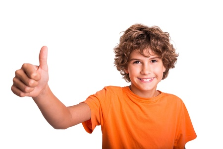 Young boy is happy  Thumb up and smiling  photo