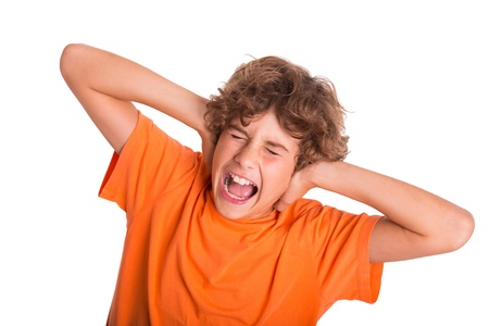 Young kid is frustrated by the noise around him Stock Photo - 16521218