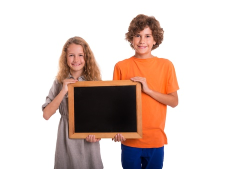 Cute girl and boy hold a small blackboard and are smiling into the camera photo
