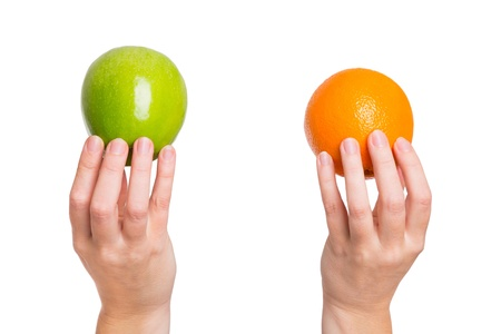 differentiation: Compare apples with oranges Stock Photo