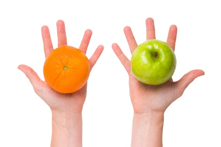 differentiation: Compare apples with oranges  conceptual  Stock Photo