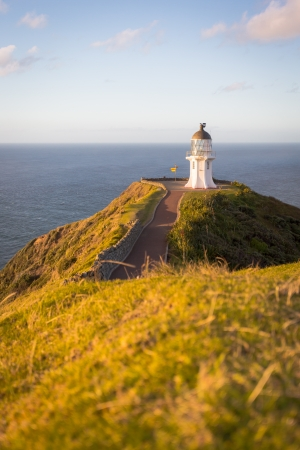 Cape Reinga on the North Island of New Zealand  Pacific Ocean hitting the Tasman Sea  photo
