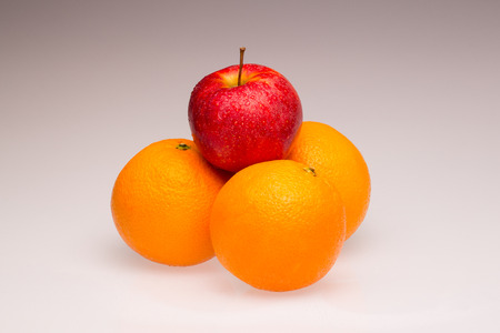 differentiation: Oranges and a red apple as a symbol and concept for differentiation and competition Stock Photo