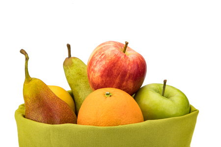 Green and fresh fruit basket with apples, oranges and pears. Stock Photo