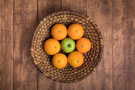 Fresh fruit basket with apples and oranges Stock Photo