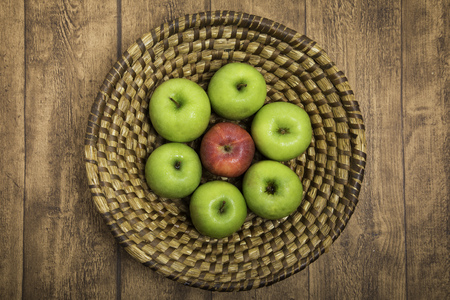 Retro style fruit basket with fresh red and green apples Stock Photo
