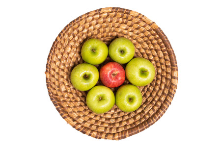 Retro style fruit basket with fresh red and green apples isolated on white background