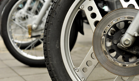 three objects: motocycle wheel and disc break